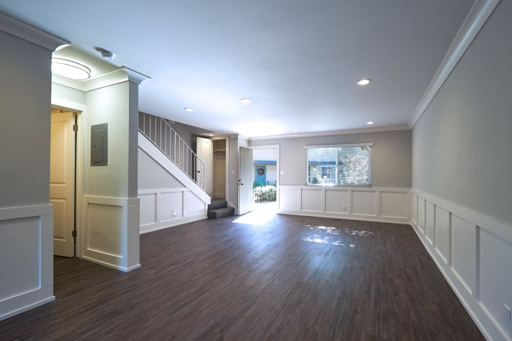 Spacious living room with wood-style flooring at Allure in Alamo, California