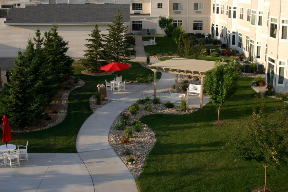 Covered outdoor seating at Touchmark at Harwood Groves in Fargo, North Dakota
