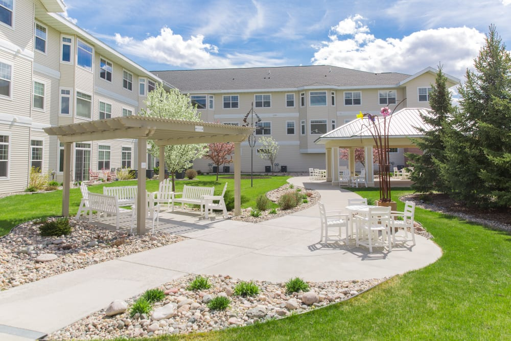 Seating in the courtyard at Touchmark at Harwood Groves in Fargo, North Dakota