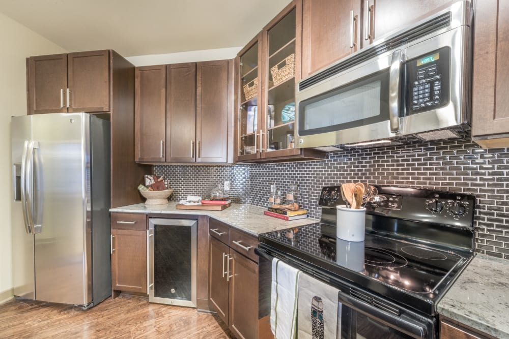 Modern kitchen with stainless steel appliances at Aviator West 7th in Fort Worth, Texas