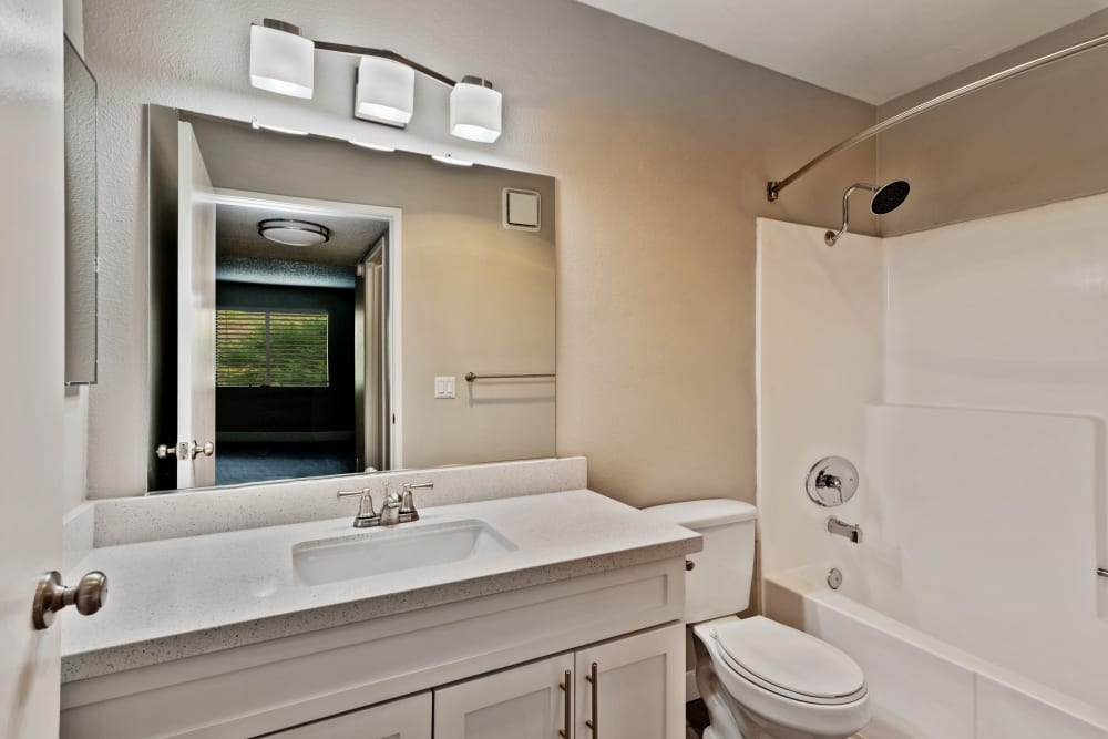 Model bathroom with natural colored cabinetry at Presidio at Rancho Del Oro in Oceanside, California