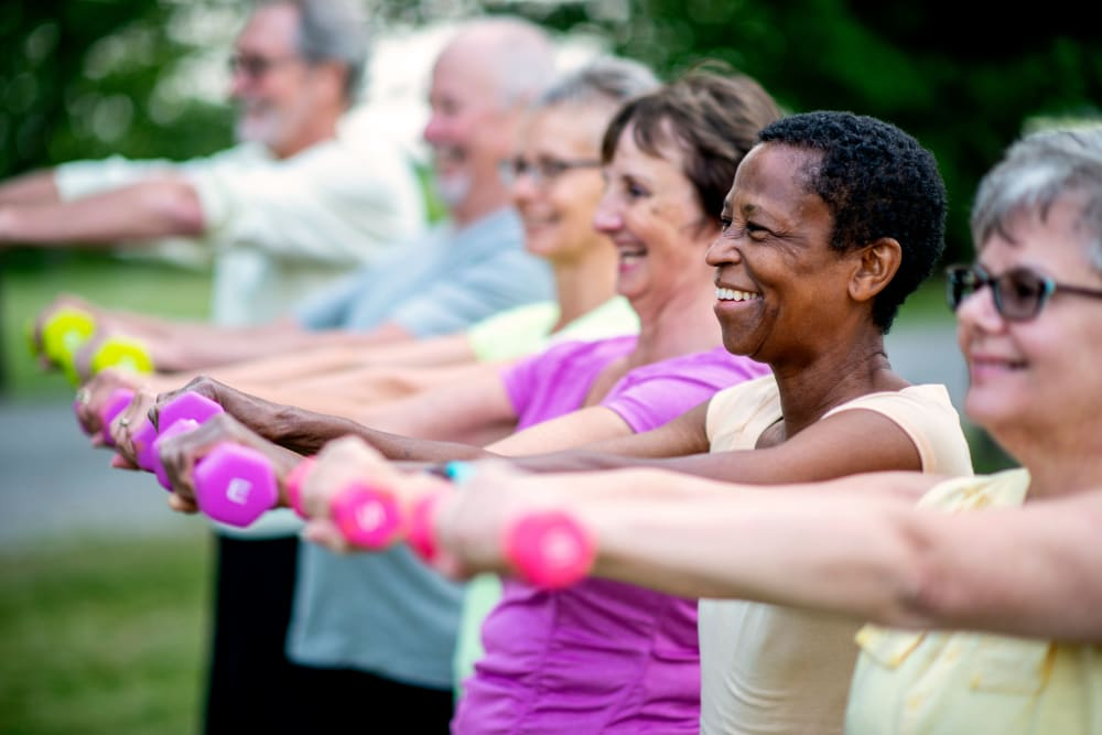 Outdoor fitness class with weights at Keystone Place at Wooster Heights in Danbury, Connecticut
