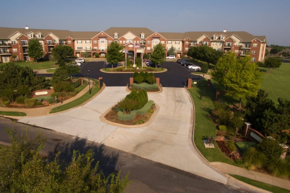 Building exterior and driveway at Touchmark at Coffee Creek in Edmond, Oklahoma