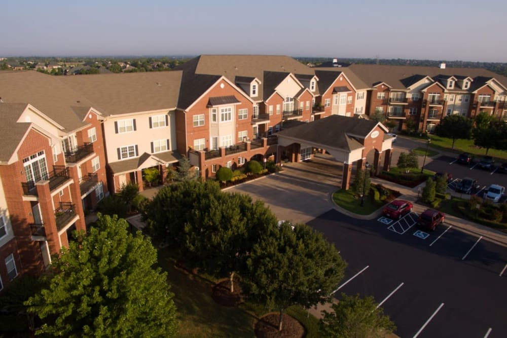 An aerial view of the main entrance and apartments at Touchmark at Coffee Creek in Edmond, Oklahoma