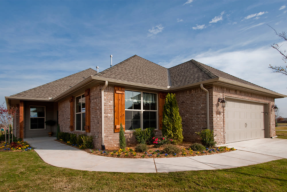 Single-family home exterior at Touchmark at Coffee Creek in Edmond, Oklahoma