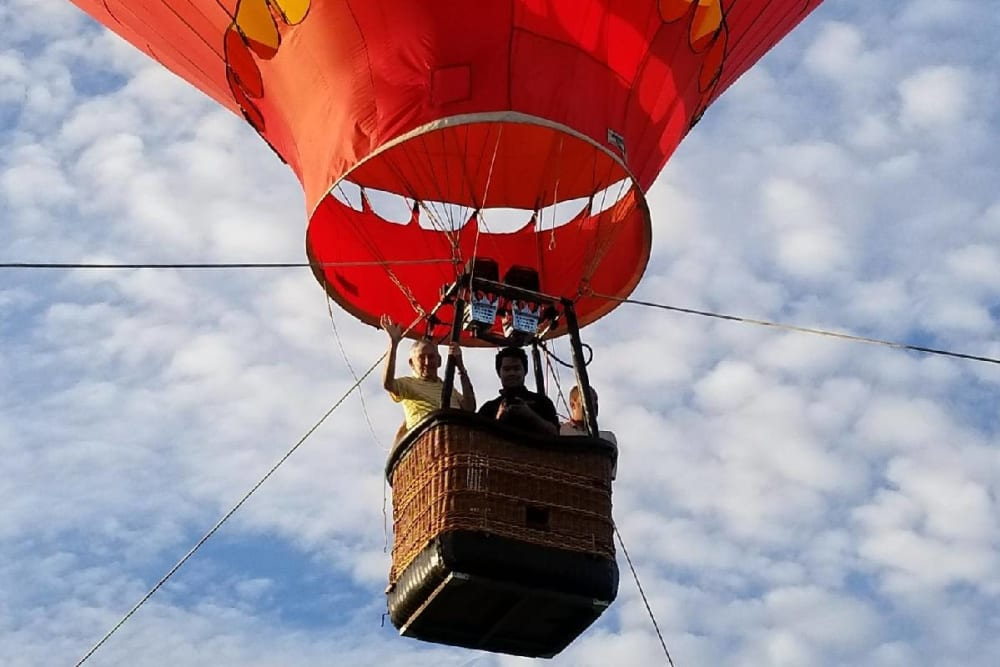 Residents from Touchmark at Coffee Creek in Edmond, Oklahoma in a hot air balloon