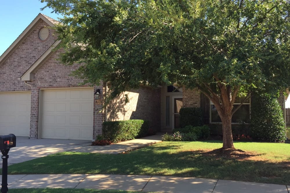 A home with a two car garage at Touchmark at Coffee Creek in Edmond, Oklahoma