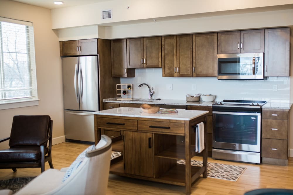 An apartment kitchen with stainless steel appliances at Touchmark at All Saints in Sioux Falls, South Dakota