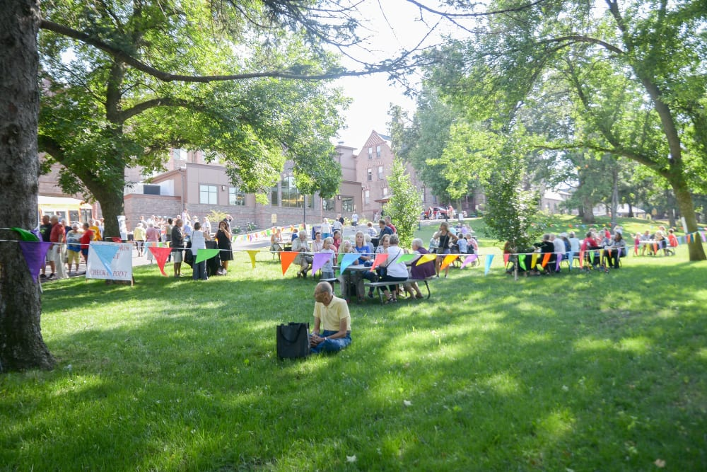 Residents enjoying an outdoor event at Touchmark at All Saints in Sioux Falls, South Dakota