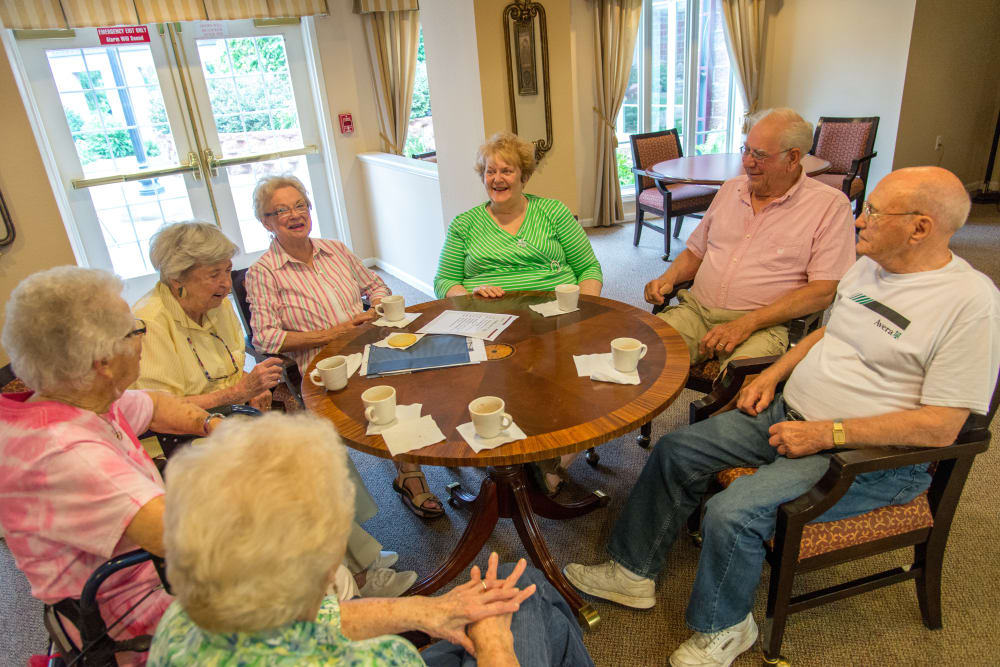 Residents having drinks together at Touchmark at All Saints in Sioux Falls, South Dakota