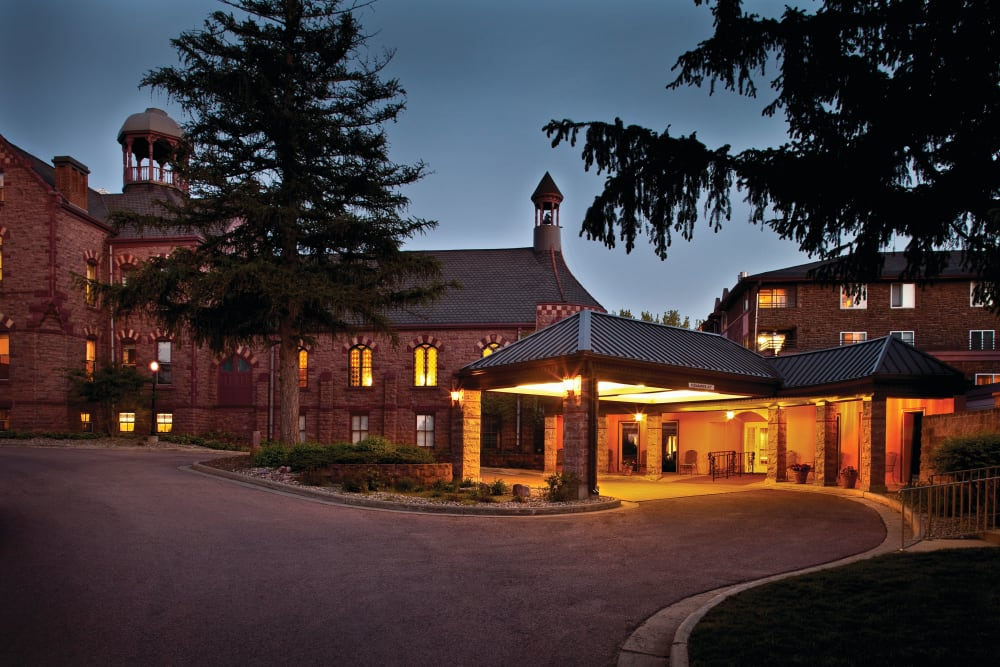 Outdoor lighting of the main entrance at night at Touchmark at All Saints in Sioux Falls, South Dakota