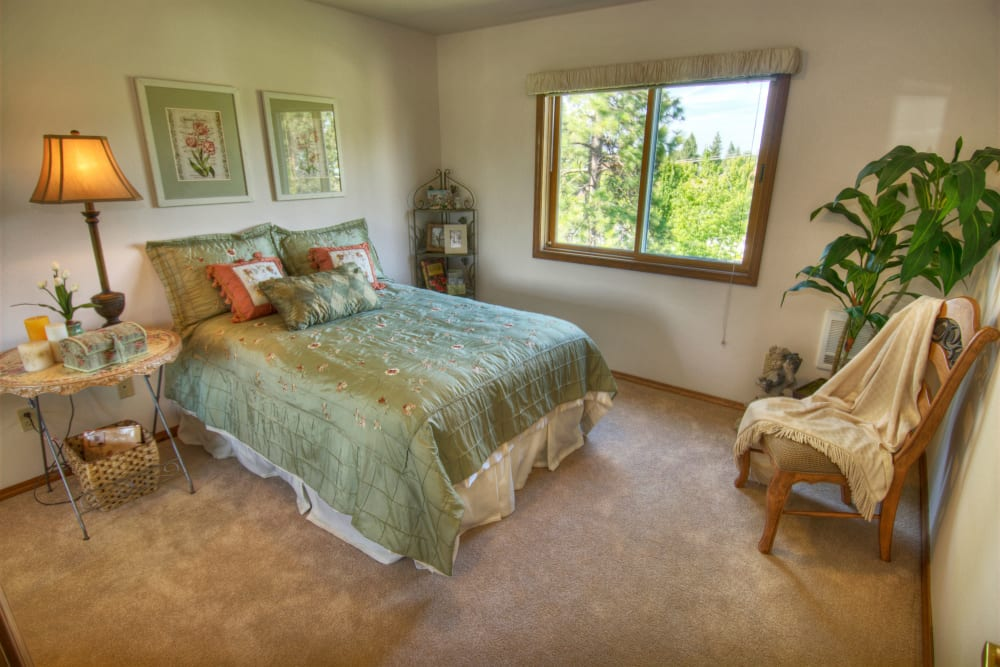 A spacious apartment bedroom at Touchmark on South Hill in Spokane, Washington