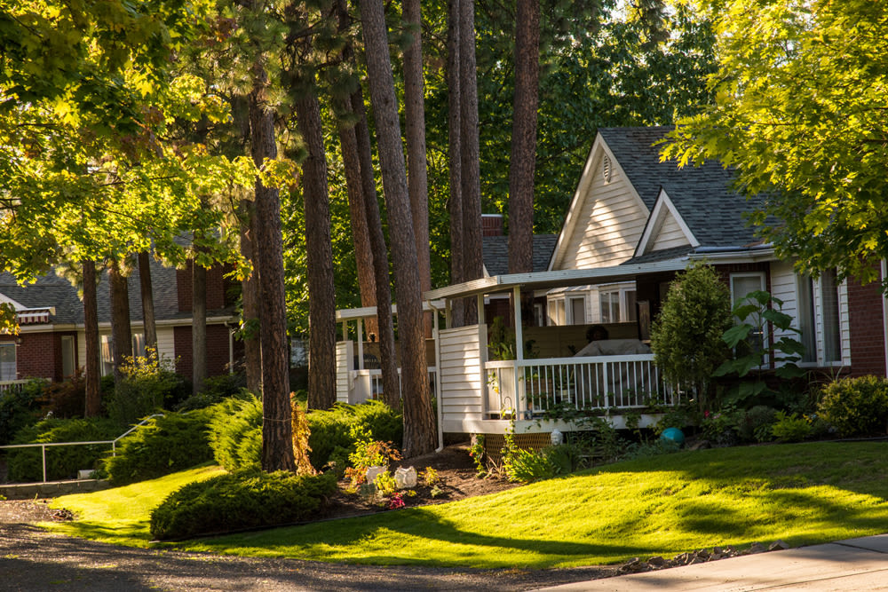 An independent living cottage with trees around it at Touchmark on South Hill in Spokane, Washington