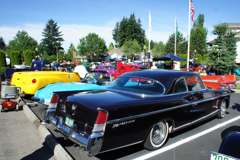 A car show in the parking lot at Touchmark at Fairway Village in Vancouver, Washington