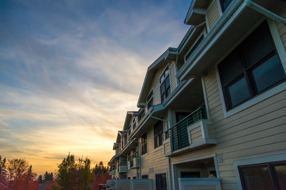 Apartment buildings exterior at dusk at Touchmark at Fairway Village in Vancouver, Washington