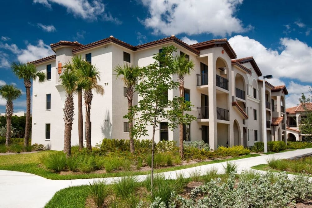 Resident buildings and walking paths at Doral View Apartments in Miami, Florida