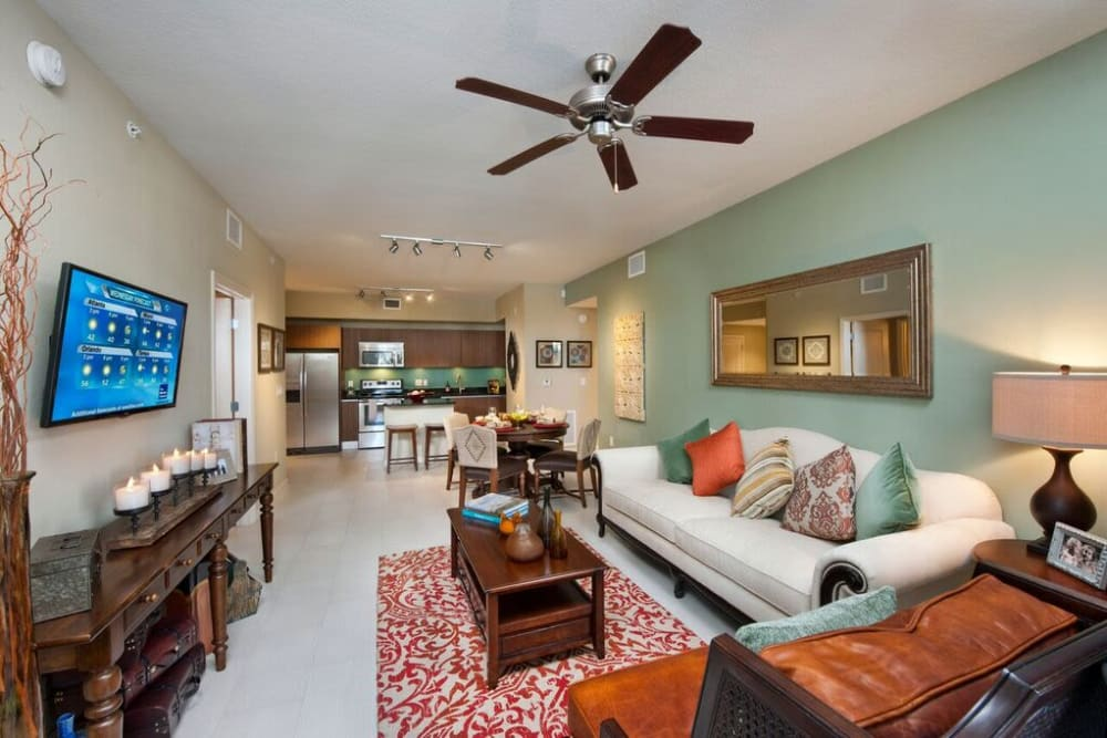 Huge open-concept floor plan of a well-decorated model home at Doral View Apartments in Miami, Florida