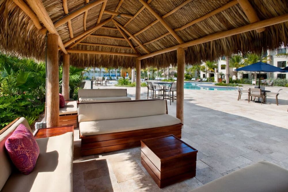 Covered cabanas near the pool at Doral View Apartments in Miami, Florida