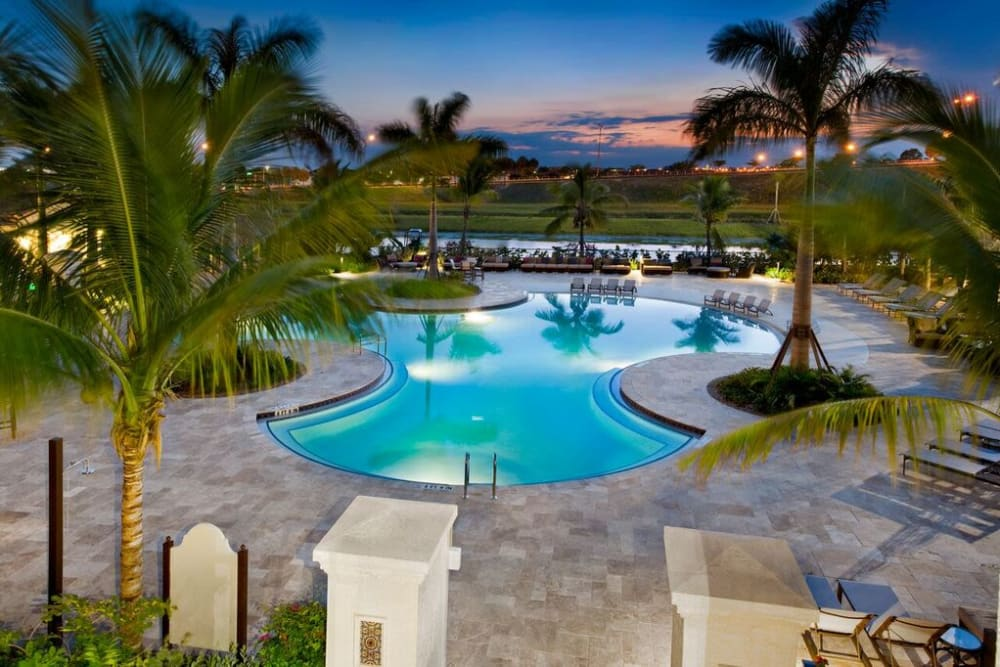 Dusk at the swimming pool area at Doral View Apartments in Miami, Florida