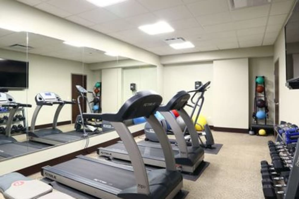 Bright fitness center for residents at 301 Riverwalk Place in Buffalo Grove, Illinois