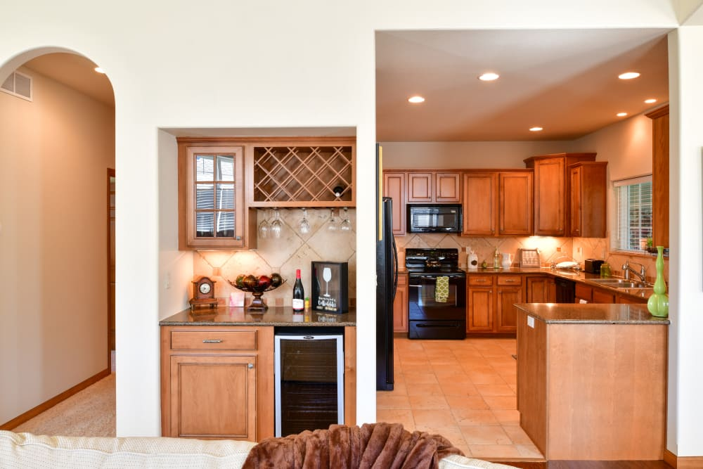 A cottage kitchen with tile flooring at Touchmark on West Prospect in Appleton, Wisconsin