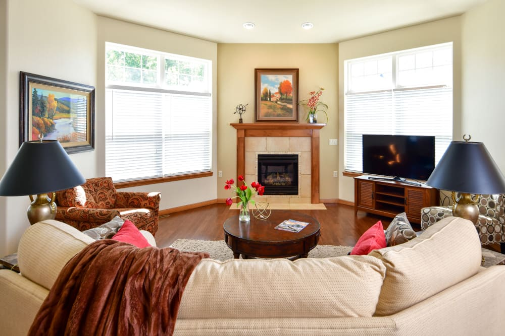 An apartment living room with a fireplace at Touchmark on West Prospect in Appleton, Wisconsin