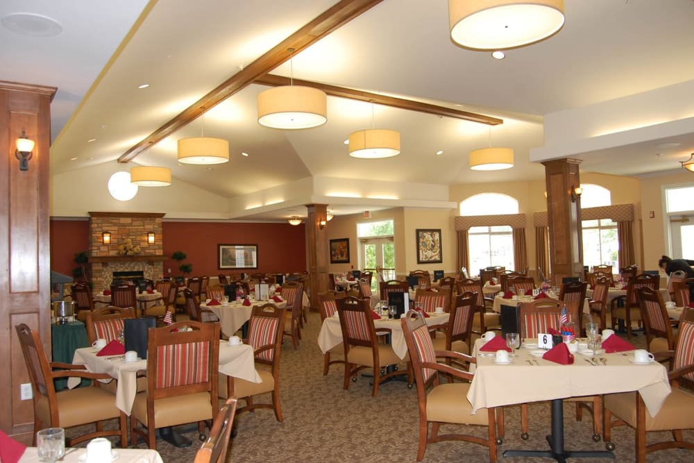 The community dining room with decorated tables at Touchmark on West Prospect in Appleton, Wisconsin