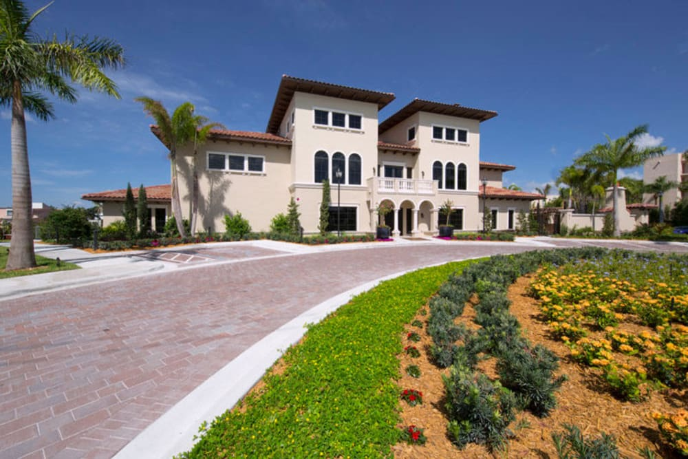 View of the driveway leading to the leasing office at Town Fontainebleau Lakes Apartment Residences in Miami, Florida