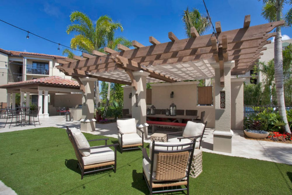 Lounge seating outside at Town Fontainebleau Lakes Apartment Residences in Miami, Florida