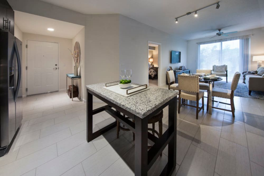 Open-concept layout with tiled floors in a model home at Doral Station in Miami, Florida