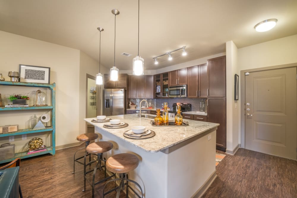 Kitchen with a gourmet prep island at Aviator West 7th in Fort Worth, Texas