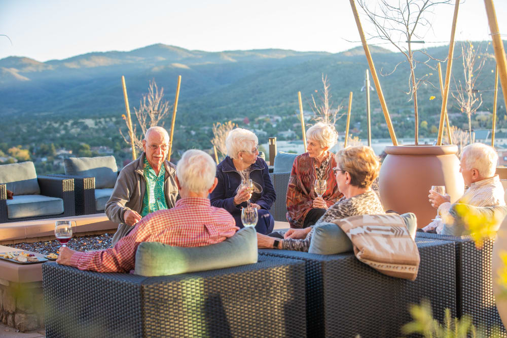 A group of residents enjoying the cool evening air at Touchmark at The Ranch in Prescott, Arizona