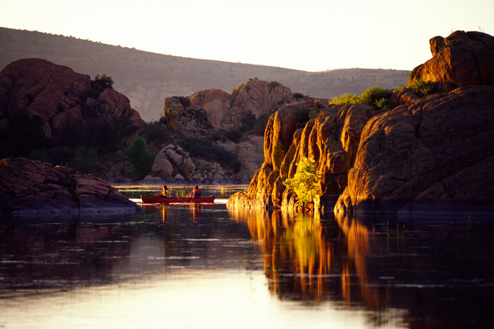 Two residents canoeing at sunset near Touchmark at The Ranch in Prescott, Arizona