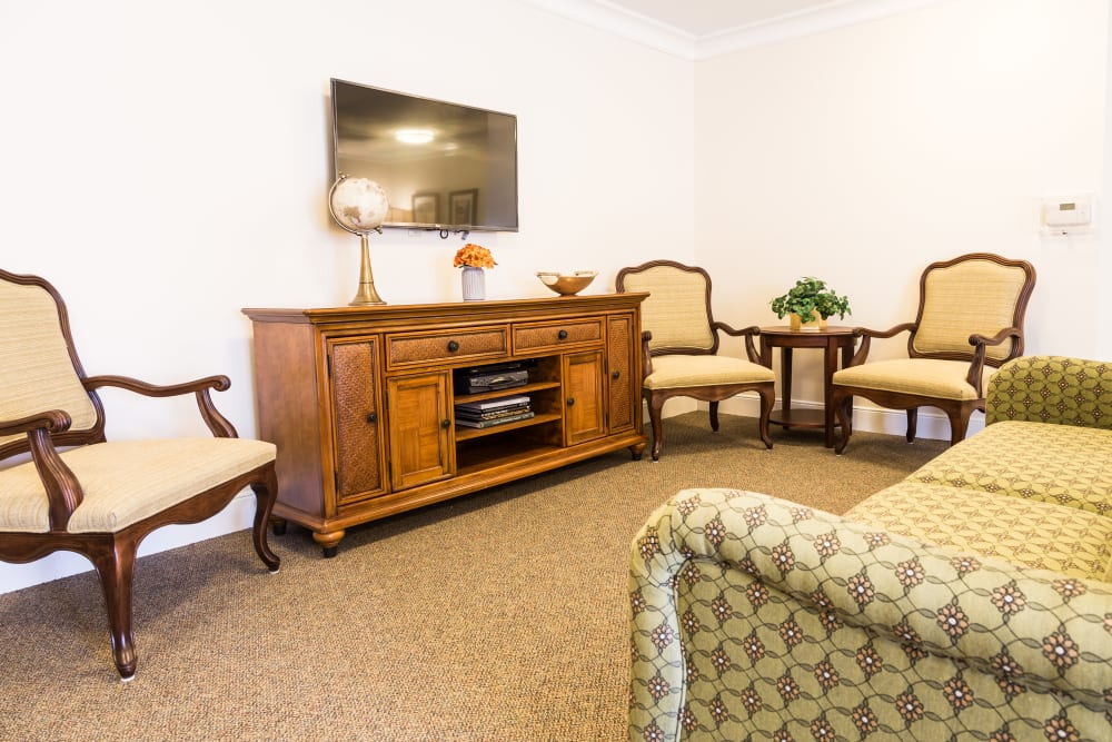 A couch in front of a television at Artis Senior Living of Brick in Brick, New Jersey