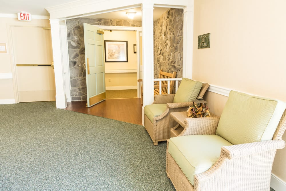 A love seat and chair at Artis Senior Living of Brick in Brick, New Jersey