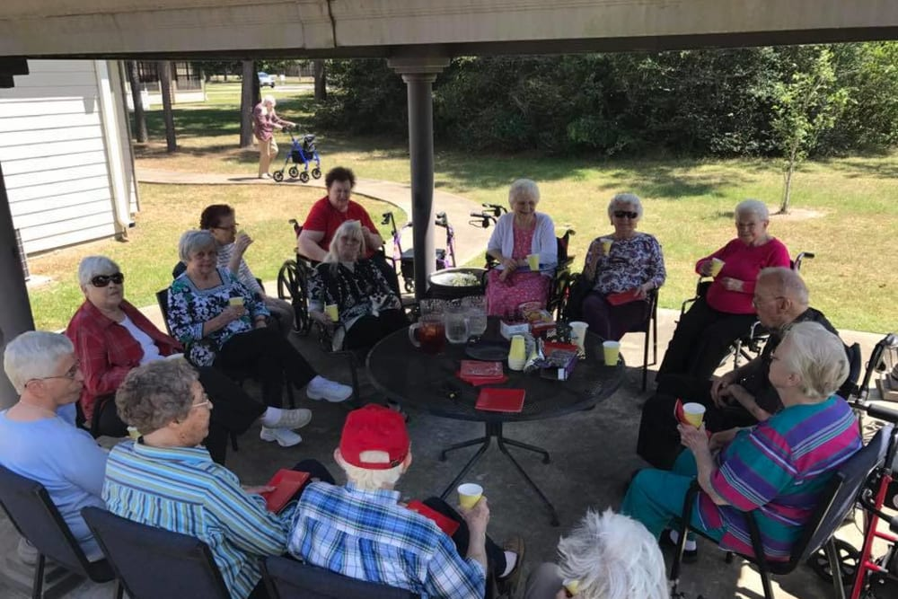 Residents gathering outside at Parsons House Cypress in Cypress, Texas