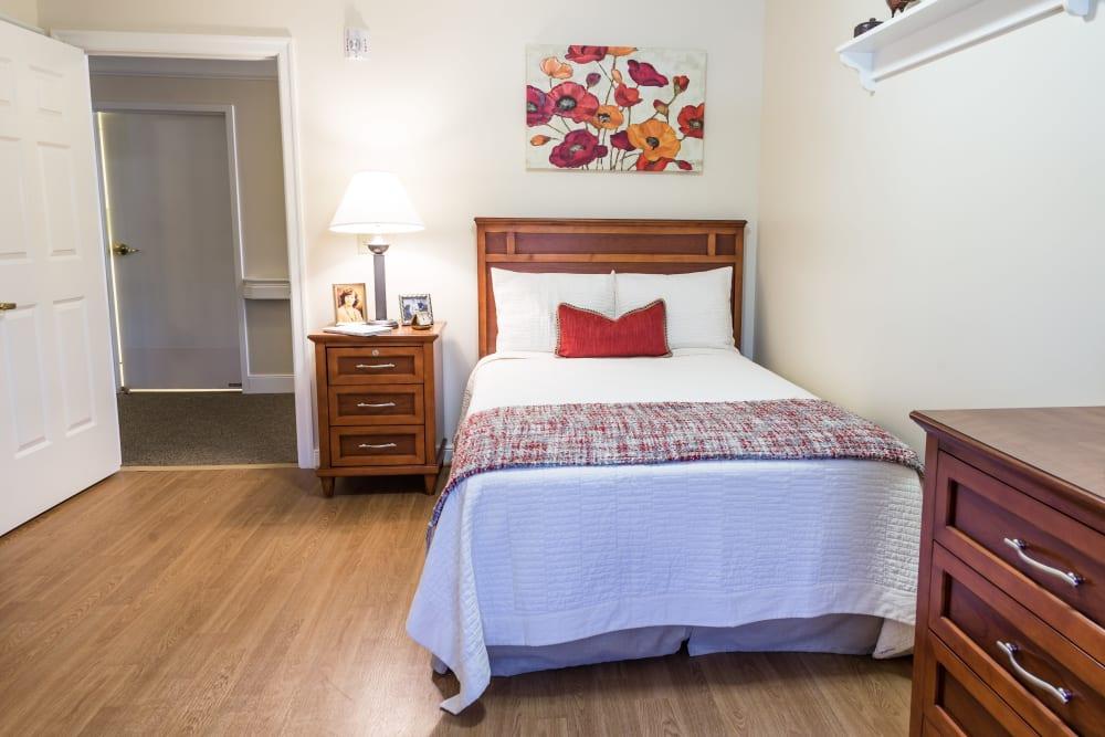 A well decorated bedroom at Artis Senior Living of Chestnut Ridge in Chestnut Ridge, New York