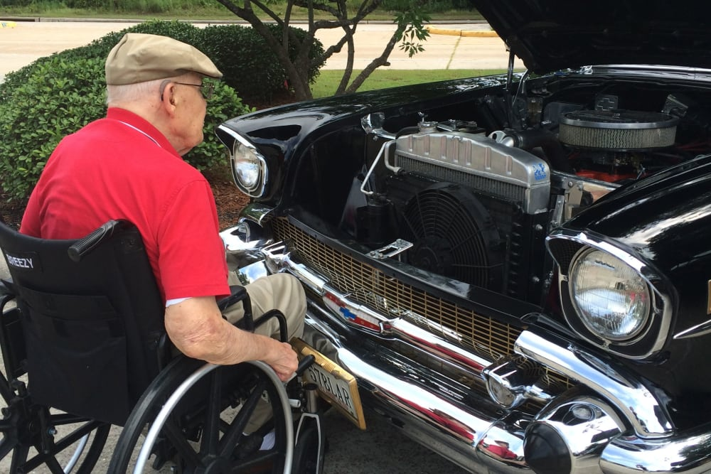 Resident under the hood of his car at Parsons House Cypress in Cypress, Texas
