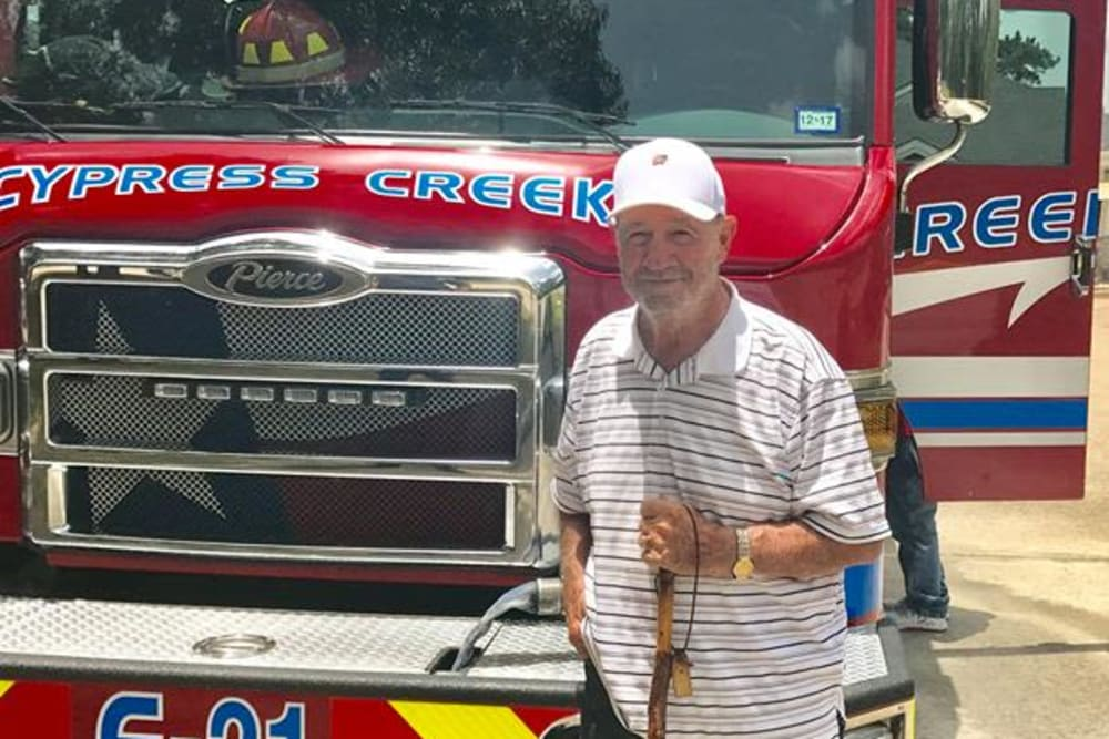 Resident by firetruck at Parsons House Cypress in Cypress, Texas