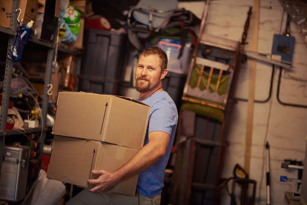 Man loading a storage unit at DELETED - DeLand Self Storage in DeLand, Florida