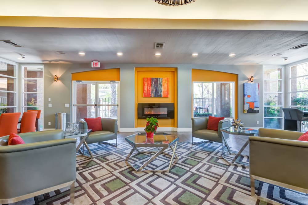 Resident lounge with fireplace at Tuscany Village Apartments