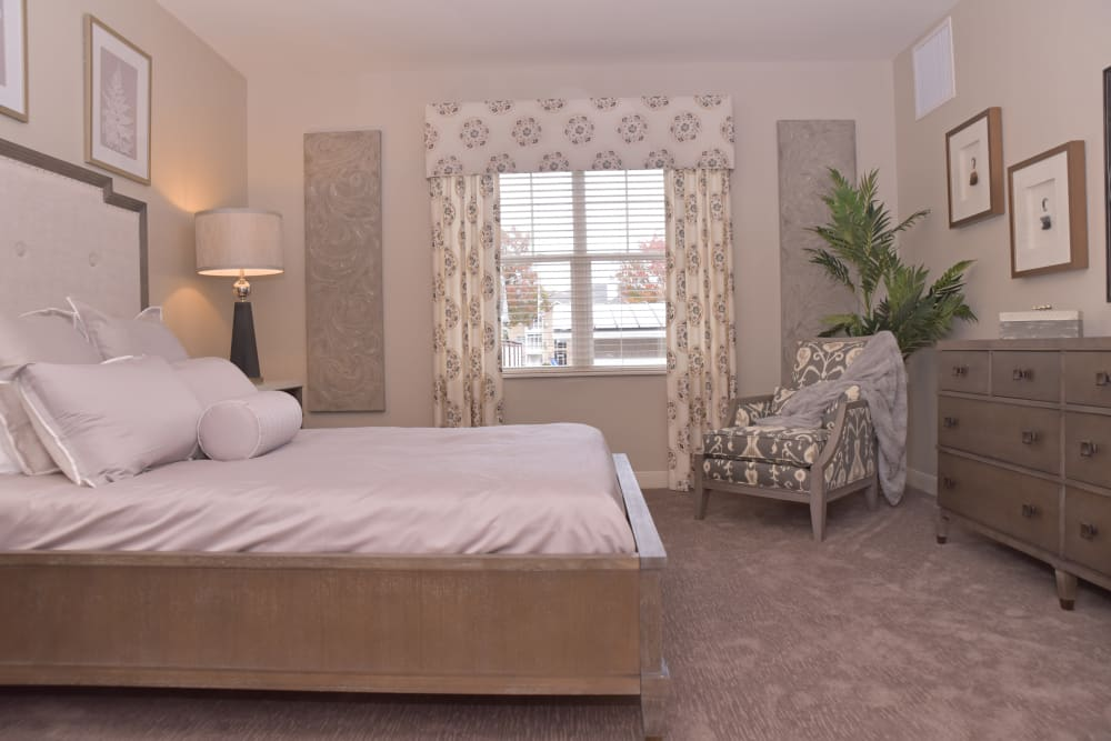 A decorated apartment bedroom at Smith's Mill Health Campus in New Albany, Ohio