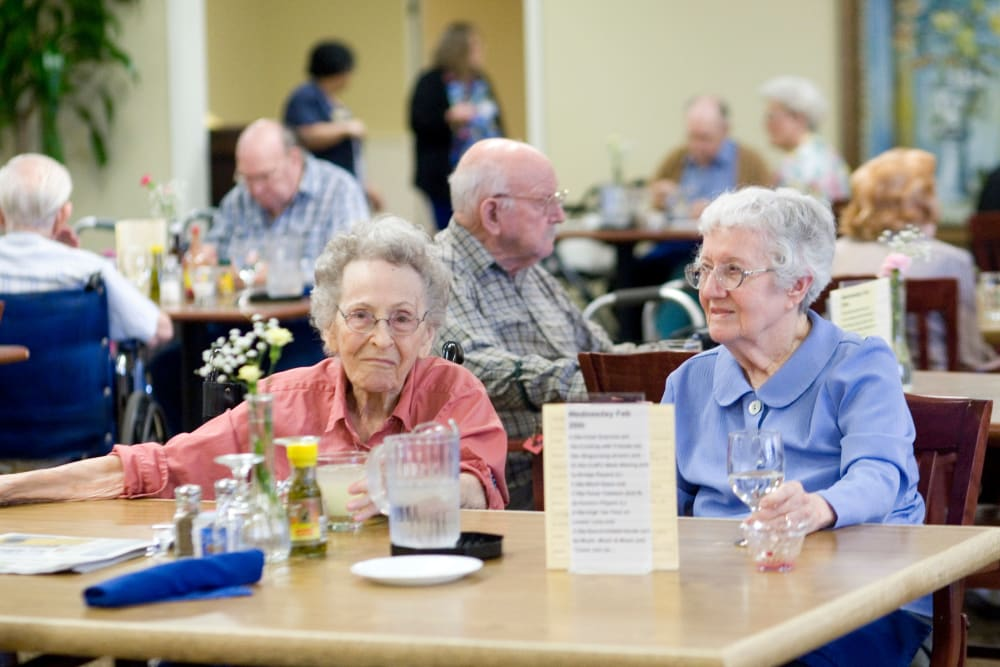 Two residents at a gathering at Parsons House Austin in Austin, Texas