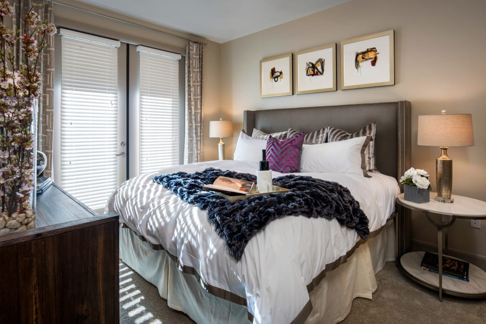 Large master bedroom with beautiful furnishings in a model home at The Core Scottsdale in Scottsdale, Arizona