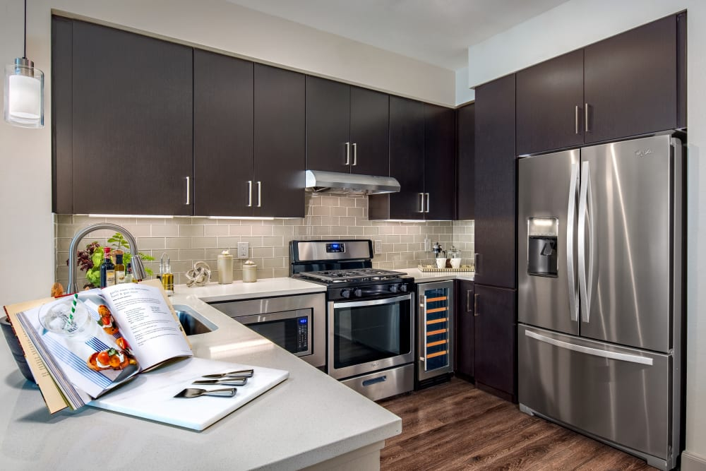 Gourmet kitchen with granite countertops in a model home at The Core Scottsdale in Scottsdale, Arizona
