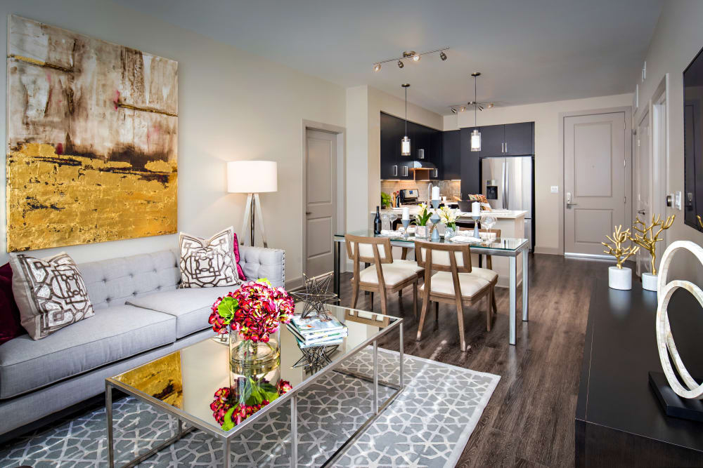 Beautiful open-concept floor plan with hardwood floors in a model home at The Core Scottsdale in Scottsdale, Arizona