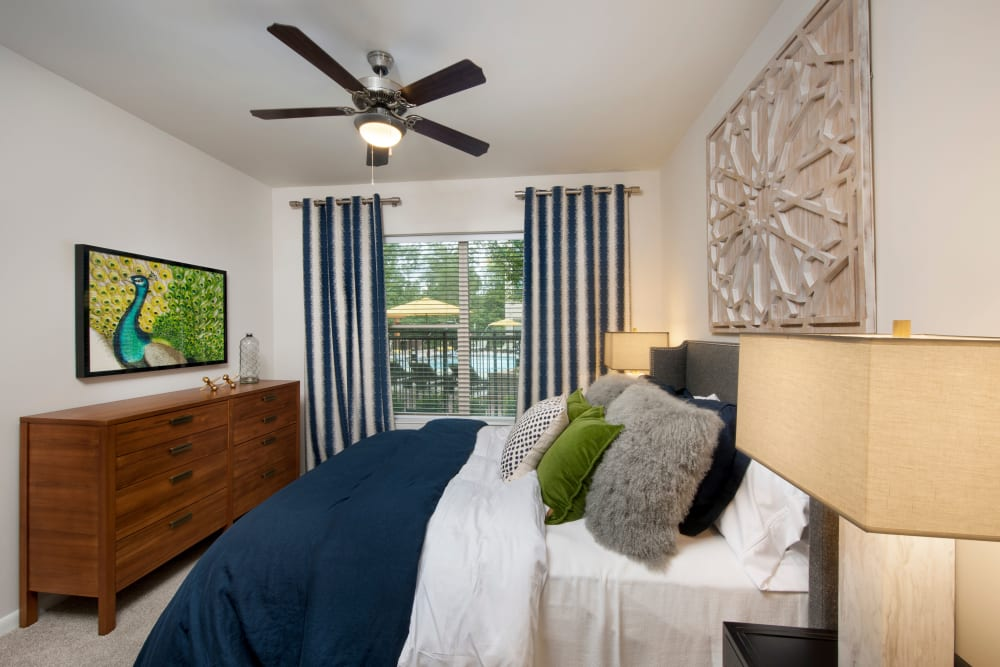Spacious bedroom with a ceiling fan at City View Vinings in Atlanta, Georgia
