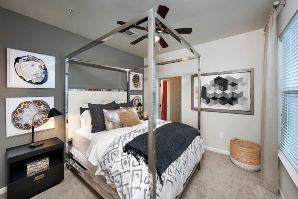 Carpeted bedroom with a ceiling fan at City View Vinings in Atlanta, Georgia