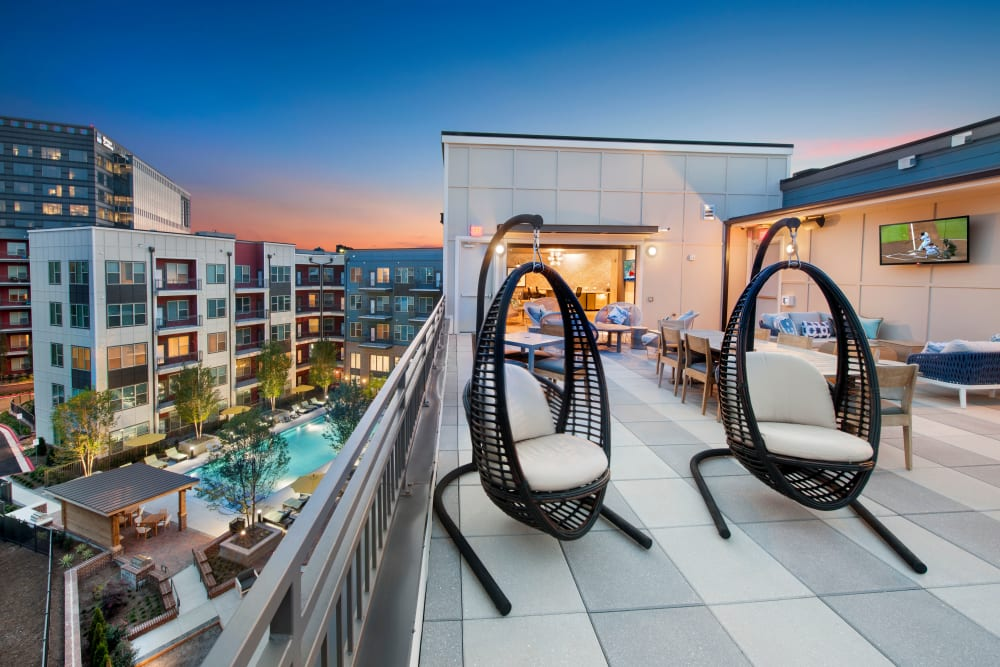 Hanging chairs on City View Vinings' sky lounge patio in Atlanta, Georgia