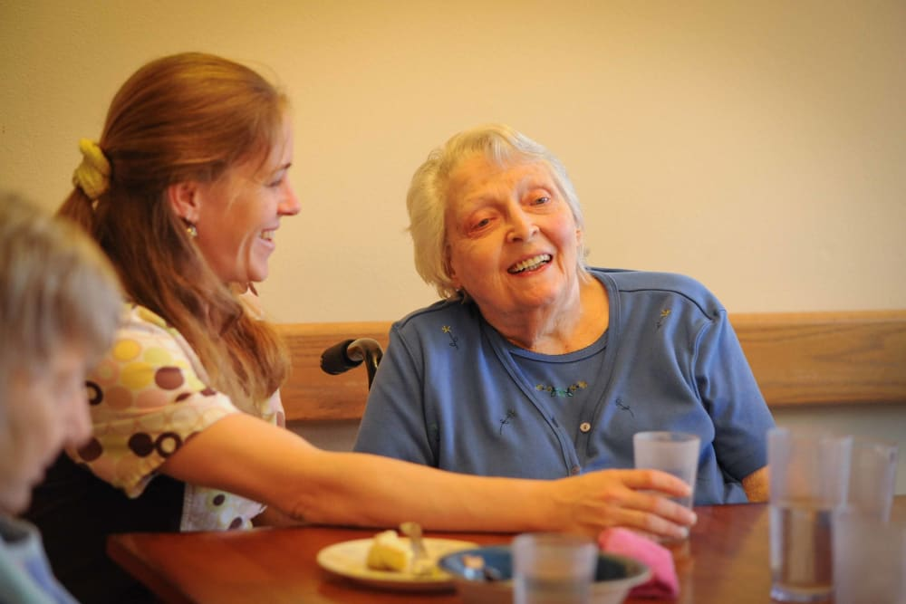 A senior having breakfast with their caretaker at Chandler House in Yakima, Washington